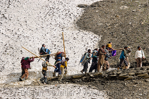 pilgrims on dandis / dolis (chairs carried by 4 porters) on trail - amarnath yatra (pilgrimage) - kashmir, amarnath yatra, bearers, dandis, dolis, hiking, hindu pilgrimage, india, kashmir, men, mountain trail, mountains, pilgrims, porters, snow, trekking, wallahs