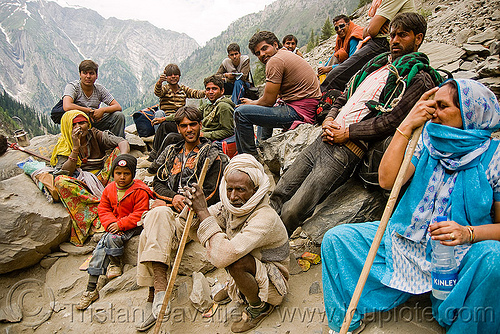 pilgrims (yatris) resting on trail - amarnath yatra (pilgrimage) - kashmir, amarnath yatra, canes, crowd, hiking, hindu pilgrimage, india, kashmir, mountain trail, mountains, pilgrims, resting, trekking, walking sticks