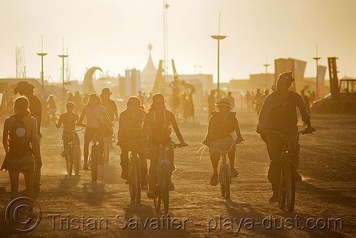 playa at dusk - burning man 2008, bicycles, bikes, dust, people