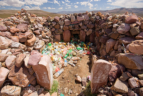 pollution - plastic bottles trash in ancient apacheta (argentina), apacheta, argentina, environment, garbage, iruya, monument, noroeste argentino, plastic bottles, plastic trash, pollution, quebrada de humahuaca, shrine