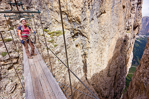 ponte tridentina - footbridge - via ferrata tridentina (dolomites), alps, catwalk, chasm, cliff, climber, climbing harness, climbing helmet, crossing bridge, dolomites, dolomiti, ferrata tridentina, footbridge, mountain climbing, mountaineer, mountaineering, mountains, people, ponte tridentina, rock climbing, suspension bridge, vertical, via ferrata brigata tridentina, woman