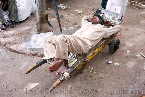 porter sleeping - delhi (india), bare feet, barefoot, bearer, cart, man, napping, porter, resting, sleeping, street, wallah