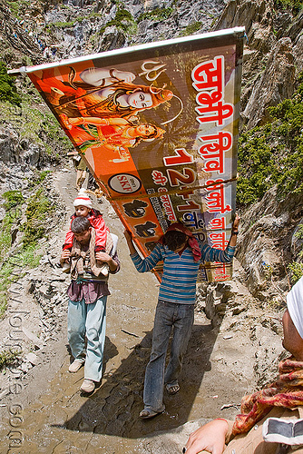 porter with large sign on trail - amarnath yatra (pilgrimage) - kashmir, amarnath yatra, bearer, hiking, hindu pilgrimage, india, kashmir, men, mountain trail, mountains, pilgrims, porter, sign, trekking, wallah