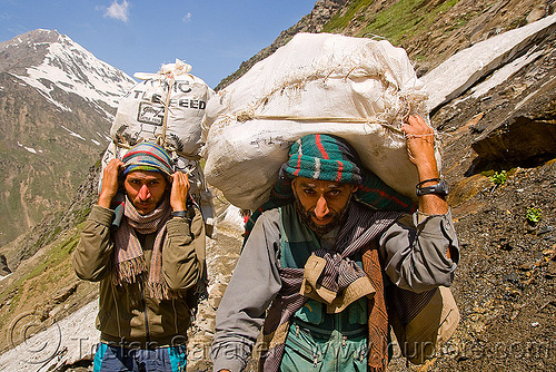porters carrying heavy loads on trail - amarnath yatra (pilgrimage) - kashmir, amarnath yatra, bags, bearers, hiking, hindu pilgrimage, india, kashmir, men, mountain trail, mountains, pilgrim, porters, snow, trekking, wallahs