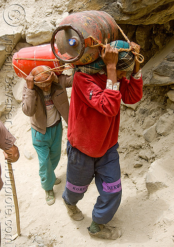 porters carrying heavy gas bottles on trail - amarnath yatra (pilgrimage) - kashmir, amarnath yatra, bearers, bottled gas, gas bottles, kashmir, loads, mountain trail, mountains, natural gas, pilgrimage, porters, supplies, trekking, wallahs, अमरनाथ गुफा