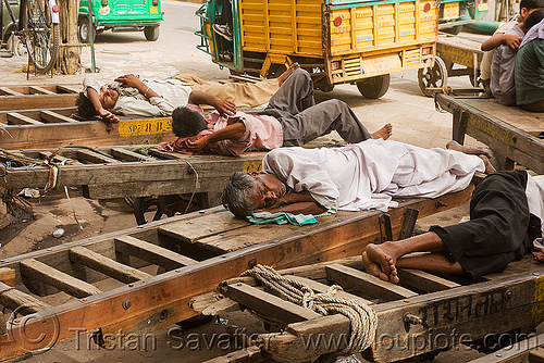 porters sleeping on their carts - delhi (india), bare feet, barefoot, bearers, men, porters, resting, sleeping, street, wallahs, wooden carts