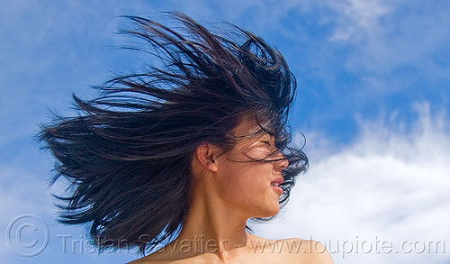 portrait of young chinese woman with hair in the wind, blowing, blue sky, chinese, clouds, wind, windy, woman