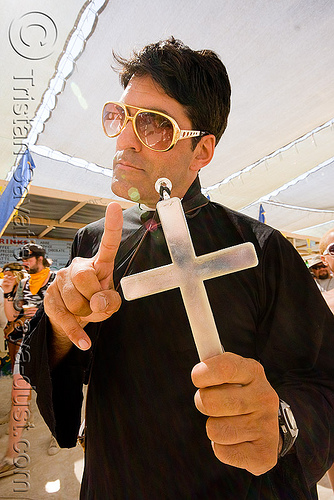 priest with cross by blinky elvis - burning man 2008, blinky elvis, center camp, cross, elvis impersonator, man, priest, sunglasses