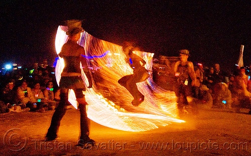 procession ceremonial flame - fire conclave - fire jumping rope - burning man 2009, burning man, fire conclave, fire dancer, fire dancing, fire jumping rope, fire performer, fire rope, fire spinning, flames, night of the burn, rope jumping, skipping rope, spinning fire