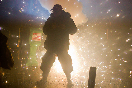 pyrotechnic explosion, backlight, chinatown, chinatown bang, chinese new year, firecrackers, lunar new year, man, night, people, pyrotechnics, silhouette, smoke, sparks, street