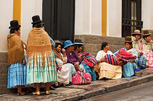 quechua women - street - la paz (bolivia), bowler hats, curb, indigenous, la paz, quechua, sidewalk, sitting, squat, squatting, street, women