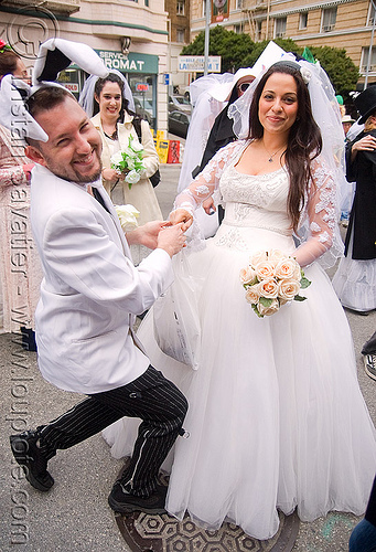 rabbit proposing to bride - diana furka - brides of march (san francisco), bridal bouquet, bride, brides of march, flowers, man, wedding dress, white roses, woman