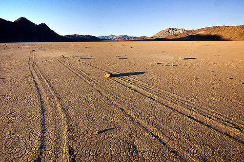 racetrack (death valley), cracked mud, death valley, desert, dry lake, dry mud, mountains, moving rocks, racetrack playa, sailing stones, sliding rocks, tracks