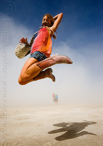 rachel jumping - burning man 2009, burning man, cowboy boots, flying, jump shot, jumper, rachel, santiags, shadow, tiags, woman