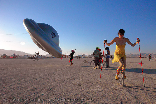 the raelians flying saucer - burning-man 2006, art, burning man, flying saucer, raelians, raeliens, ufo, unicycle, woman