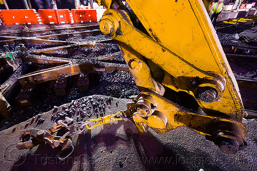rail tongs - muni railway construction site (san francisco), attachment, diamond crossing, hydraulic arm, light rail, muni, ntk, rail tongs, railroad construction, railroad tracks, railway tracks, san francisco municipal railway, track maintenance, track work