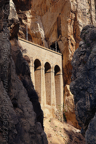 railroad viaduct along cliff - el chorro gorge (spain), canyon, cliffs, desfiladero de los gaitanes, el caminito del rey, el camino del rey, el chorro, gorge, mountain, mountaineering, rail bridge, railroad bridge, railway, viaduct