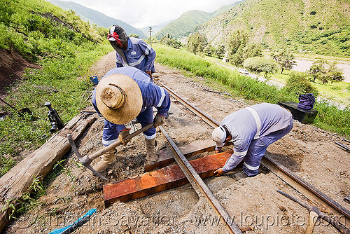 railroad workers replacing a wood tie, argentina, men, metric gauge, narrow gauge, noroeste argentino, railroad construction, railroad ties, railroad tracks, railway sleepers, railway tracks, single track, track maintenance, tren a las nubes, workers, working