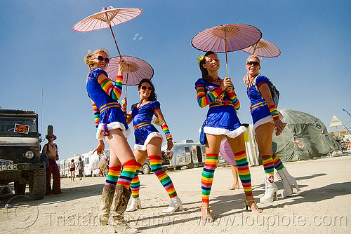the rainbow brite's - girls with rainbow tights and japanese umbrellas - burning man 2009, burning man, cosplay, japanese umbrellas, rainbow brites, rainbow colors, rainbow stockings, rainbow tights, women
