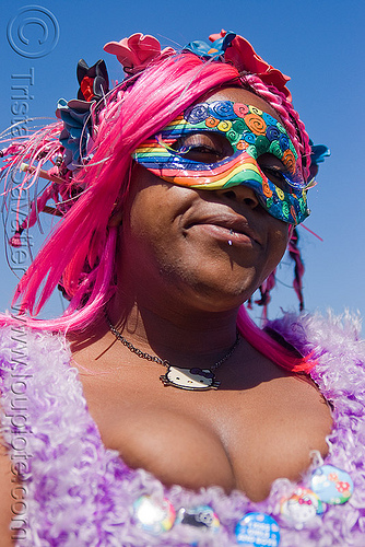 rainbow carnival mask, carnival mask, cleavage, dolores park, gay pride festival, hello kitty, lip piercing, pink hair, pink wig, rainbow colors, woman