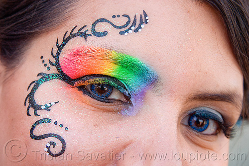 rainbow eye makeup, blue contact lenses, blue contacts, color contact lenses, colored lenses, eye makup, face painting, facepaint, gay pride festival, rainbow colors, rainbow makeup, woman