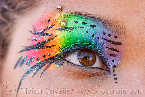 rainbow eye makeup, eye makup, eyebrow piercing, face painting, facepaint, gay pride festival, glitter, rainbow colors, rainbow makeup, woman