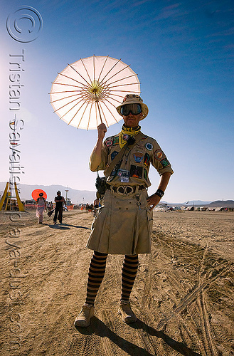 ranger with umbrella - ranger hollywood - burning man 2008, backlight, black rock ranger, brc ranger, burning man, ranger hollywood, umbrella