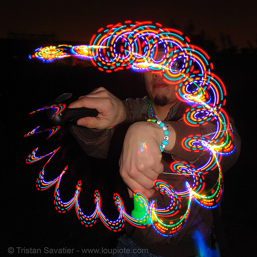 rave lights - candy kid  spinning LED-lights, glowing, kandi kid, kandi raver, led fan, led lights, lightshow, long exposure, night, plur, rave lights, raver outfits, spinning lights, toxic beach