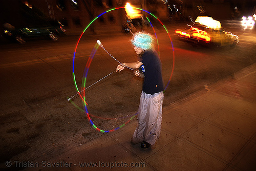 rave lights - poitoi spinning light poi in the street (san francisco), fire poi, glowing, hat, led lights, light poi, long exposure, night, people, poitoi, rave lights, raver outfits, raving, spinning light, street