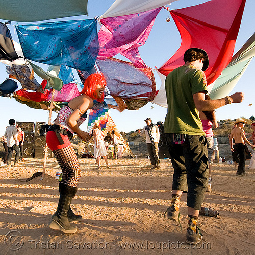 rave party in the desert, dancing