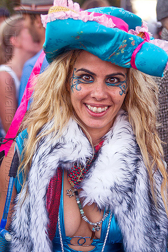 raver fashion - amit, amit, blonde, blue hat, burning man decompression, cleavage, eye makeup, fashion, furry vest, necklaces, pink ribbon, raver, woman