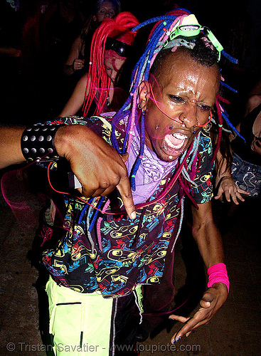 raver with EL-wire through septum piercing, african american man, black man, night, raver outfits