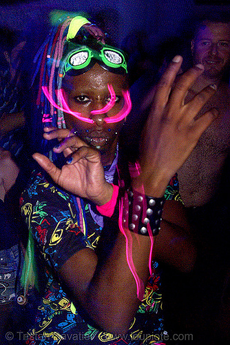 raver with EL-wire through septum piercing, african american man, black man, glowing, ignition party, led lights, lightshow, night, penny, rave lights, rave party, raver outfits