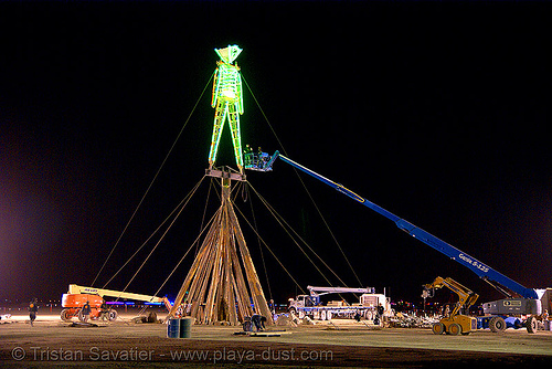 rebuilt man is installed - burning man 2007, burning man, cherry picker, crane, dpw, neon, night, the man