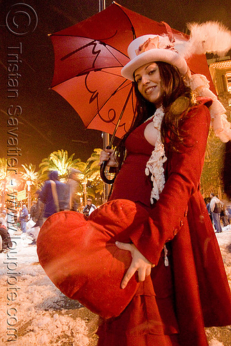 red heart pillow - woman in red - diana furka - the great san francisco pillow fight 2009, diana furka, down feathers, heart pillow, night, pillow fight club, pillows, red color, red umbrella, world pillow fight day
