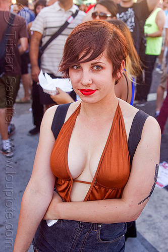 redhead woman with red lipstick and cleavage, arm tattoo, cleavage, folsom street fair, red lipstick, redhead, shiny eyes, woman