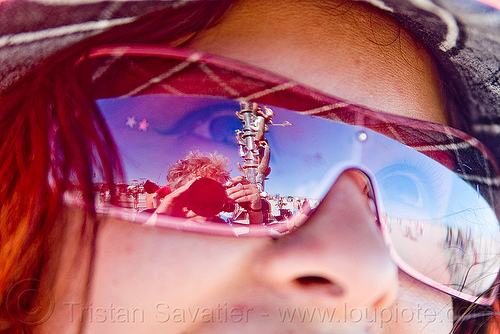 reflection of the tower in a woman's sunglasses, burning man, sunglasses, the minaret, tower, woman