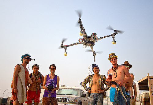 remote controlled drone - burning man 2013, burning man, drone, flying, men, multicopter, quadcopter, quadrocopter, quadrotor helicopter, rc, remote controlled, uav, unmaned aerial vehicle, video camera, virtual reality goggles, vr goggles