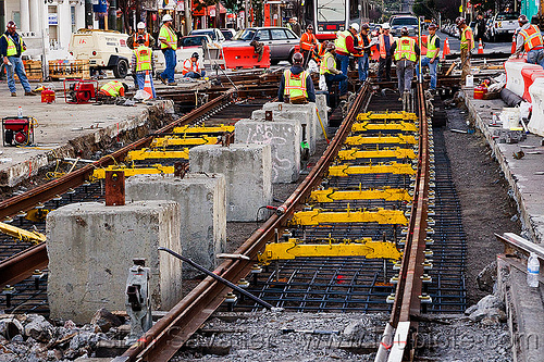 replacing tracks of the san francisco municipal railway, high-visibility jacket, high-visibility vest, light rail, man, muni, ntk, rail jacks, railroad construction, railroad tracks, rails, railway tracks, reflective jacket, reflective vest, safety helmet, safety vest, san francisco municipal railway, track jacks, track maintenance, track work, workers