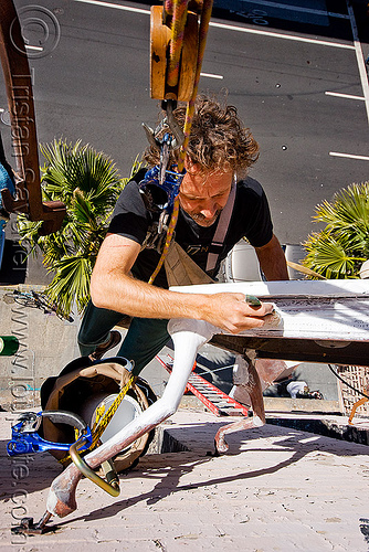restoration of the defenestration building (san francisco), artist, brian goggin, defenestration building, hanging, man, paint, painting, restoration, rope access, ropework, safety harness, street, table, wall
