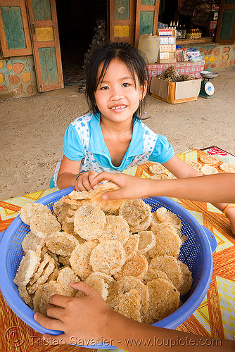 rice cookies - home made - girl - laos, laos, little girl, rice cakes, rice cookies, street market, street seller, street vendor