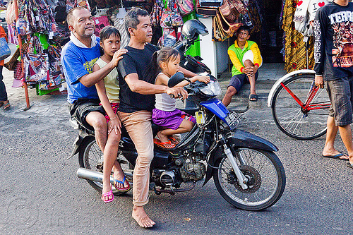 riding a motorbike in indonesia, children, four, girls, java, jogja, jogjakarta, kids, motorbike, rider, riding, street, underbone motorcycle, yogyakarta
