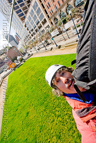 riding the zip-line over san francisco, adventure, cable line, cables, embarcadero, grass, hanging, helmet, landing, lawn, man, mountaineering, self portrait, selfie, steel cable, trolley, tyrolienne, urban, zip line, zip wire