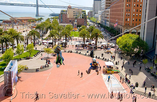 riding the zip-line over san francisco, adventure, bay bridge, cable line, cables, climbing helmet, embarcadero, extreme sport, gear, hanging, harness, jessika, justin herman plaza, mountaineering, steel cable, tower, trolley, tyrolienne, urban, woman, zip line, zip wire, ziptrek