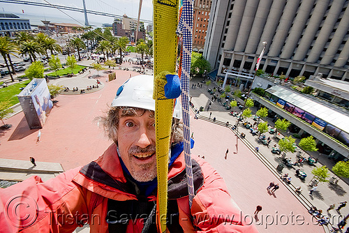 riding the zip-line over san francisco, adventure, cable line, cables, climbing helmet, embarcadero, hanging, man, mountaineering, self portrait, selfie, sling, steel cable, strap, trolley, tyrolienne, urban, zip line, zip wire