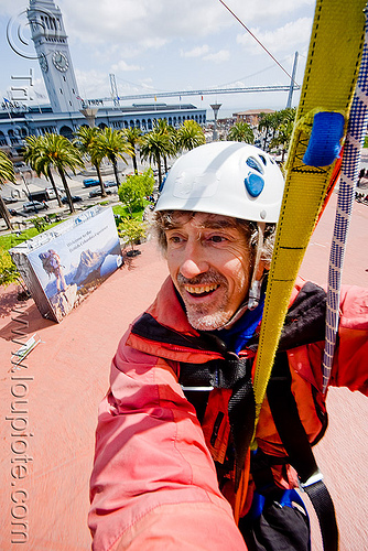 riding the zip-line over san francisco, adventure, cable line, cables, campanil, climbing helmet, clock tower, embarcadero, extreme sport, gear, hanging, harness, justin herman plaza, man, mountaineering, people, self portrait, sling, steel cable, strap, tristan savatier, trolley, tyrolienne, urban, zip line, zip wire, ziptrek