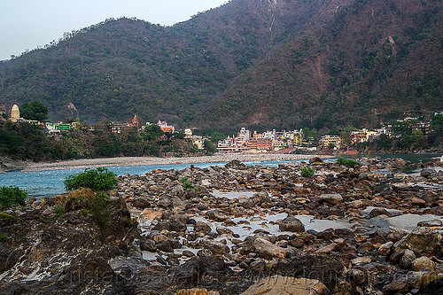 rishikesh - rocks on a beach of the ganges river (india), ashrams, buildings, forest, ganga, ganga river, hills, mountains, river bed, stones, water