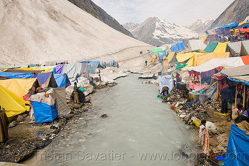 river and tent village near the cave - amarnath yatra (pilgrimage) - kashmir, amarnath yatra, encampment, kashmir, mountains, pilgrimage, pilgrims, river bed, tents, trekking, water, yatris, अमरनाथ गुफा