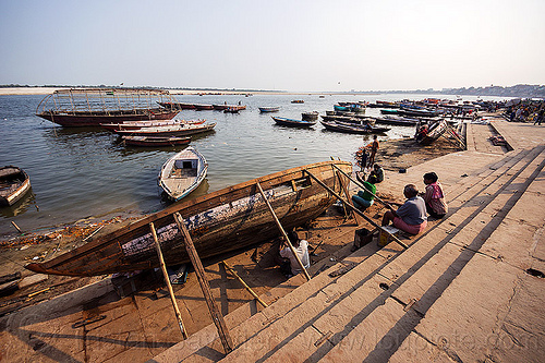 river boat being repaired on the ghats of varanasi (india), fixing, ganga, ganges river, ghats, hull, india, repairing, river bank, river boats, sticks, varanasi
