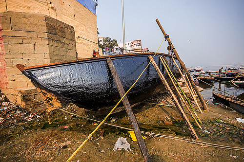 river boat with new tar coating - ghats of varanasi (india), drying, ganga river, ganges river, ghats, hull, river boat, tar, varanasi, water